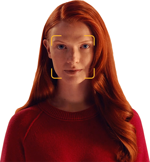 A red-haired person wearing a red sweater