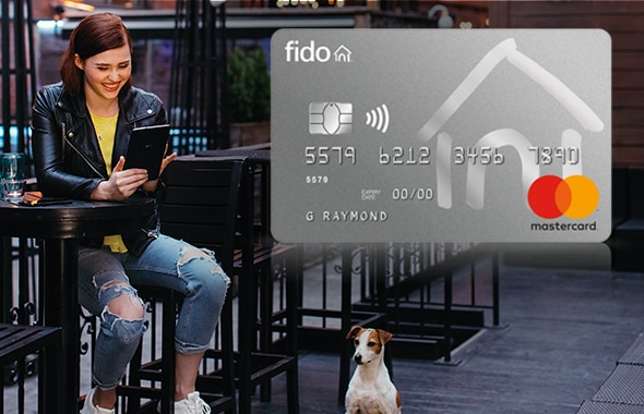A group of friends enjoys a night out for dinner and pays using their Fido Mastercard