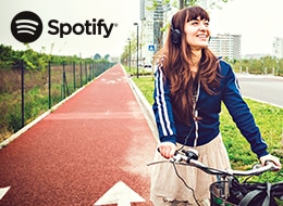 A girl rides her bike while listening to Spotify Premium, bundled with any Fido Pulse plan
